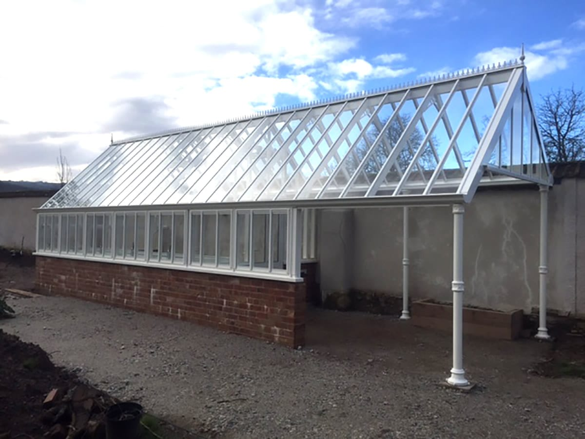 Bespoke 3/4 span greenhouse with extended roof