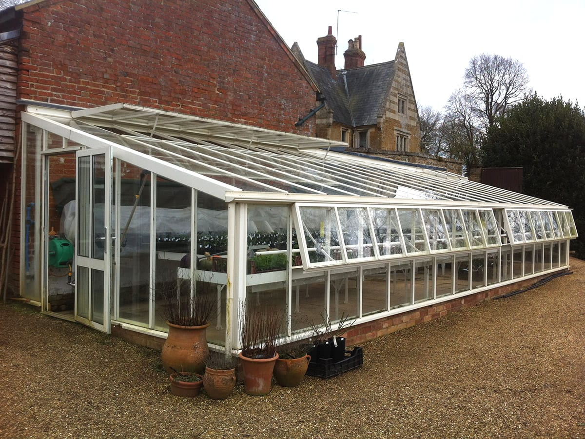 Bespoke aluminium lean to greenhouse
