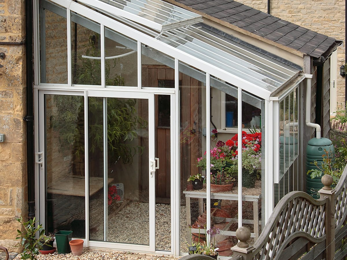 Lean-to greenhouse with sliding door