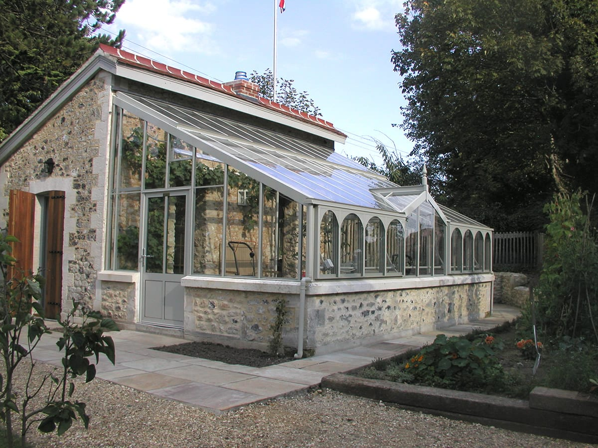 Bespoke lean to greenhouse with stone base