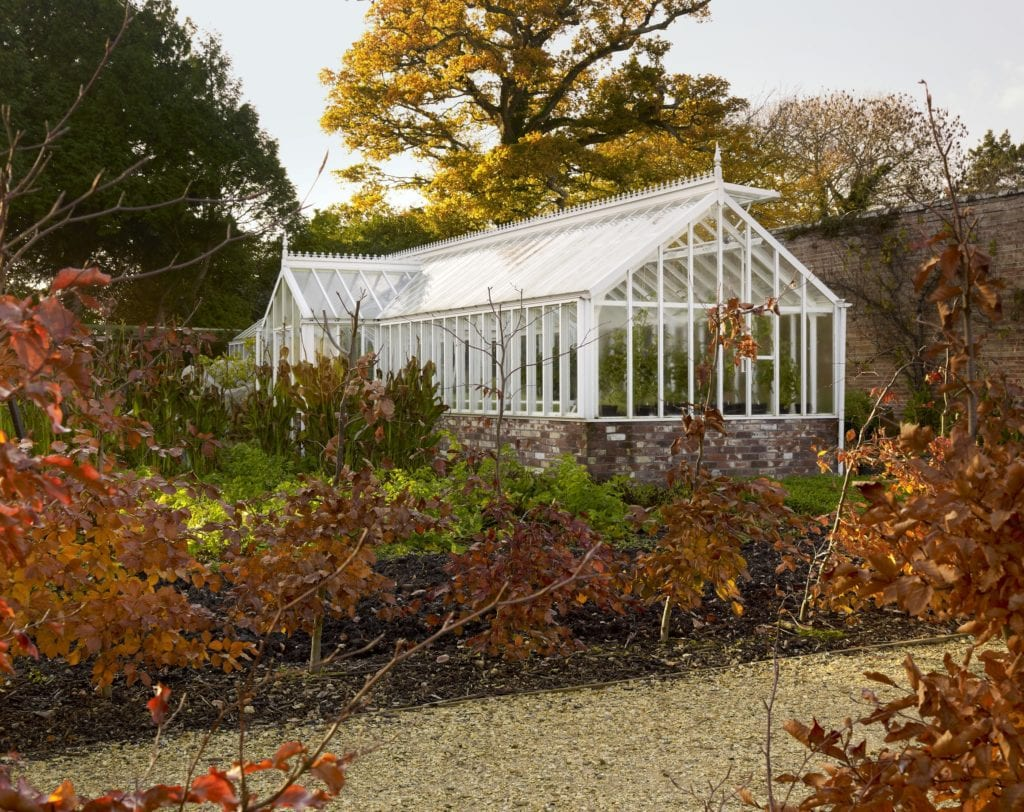 Large Victorian greenhouse in autumn