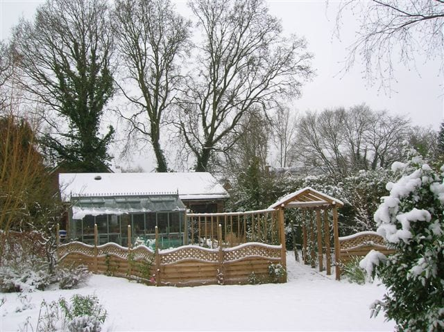 Traditional greenhouse in the snow