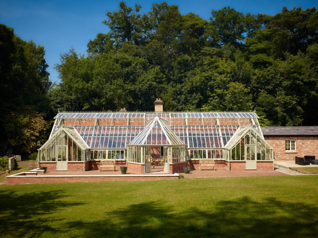 Large bespoke three quarter span greenhouse 5.5m x 19m with 3 porches and hexagonal centre porch